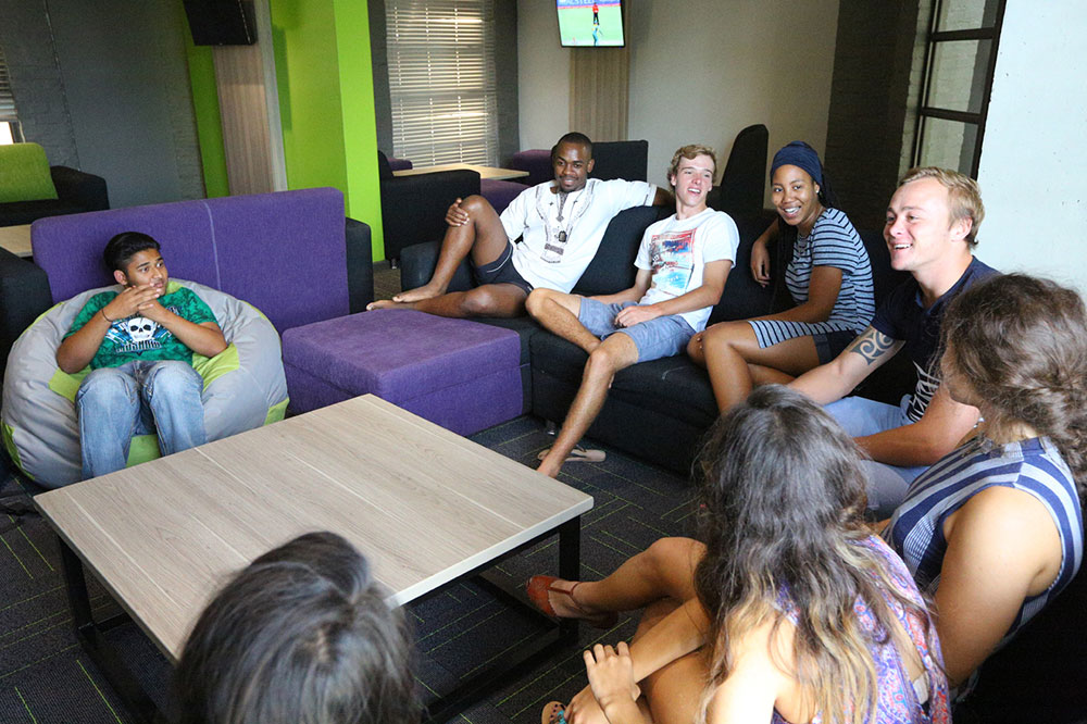 students sitting in the living room